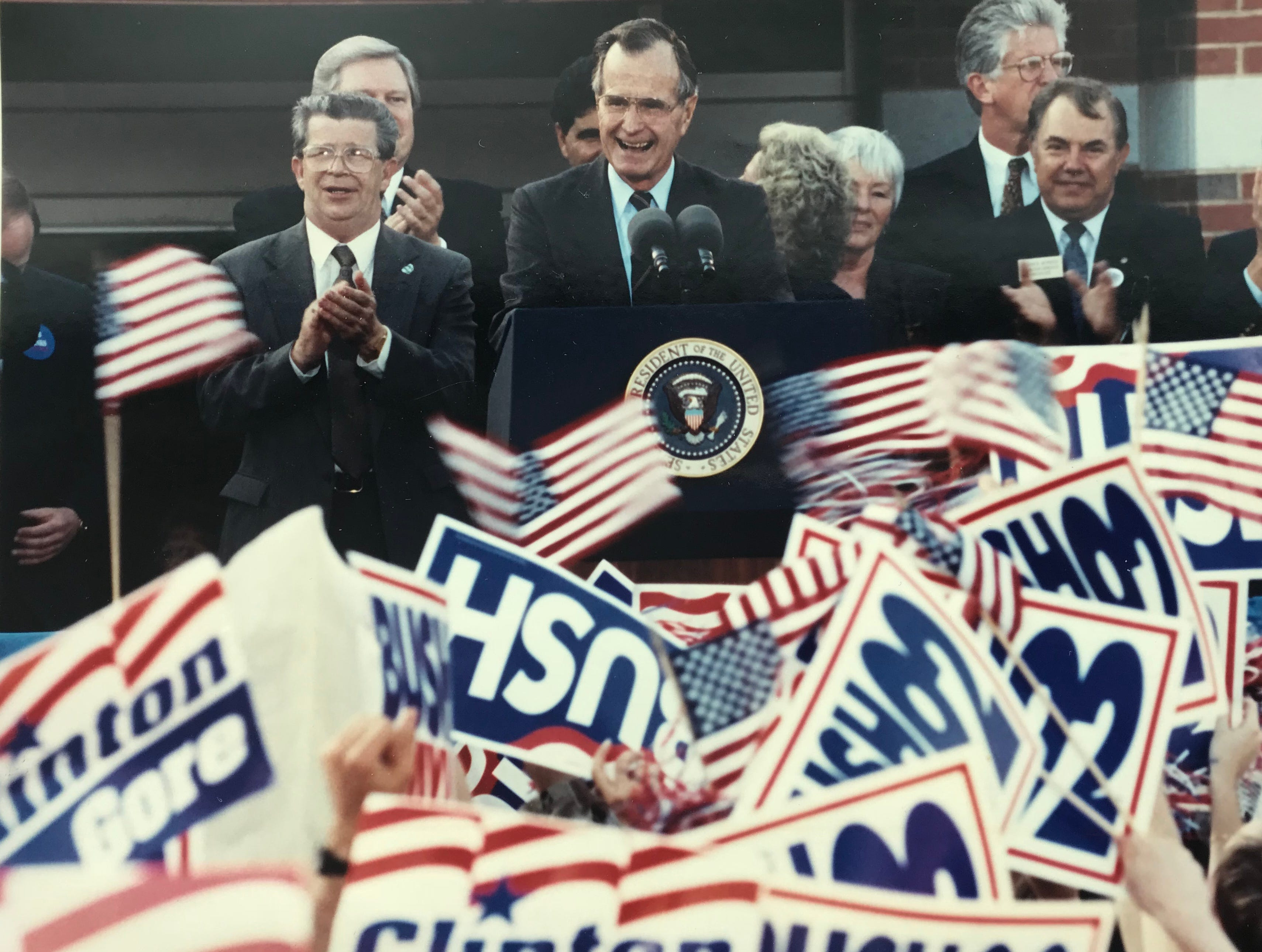 President George H.W. Bush smiles after delivering remarks during a rally at Middlesex County College on Oct. 16, 1992.
