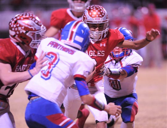 Leakey spread back Abel Montoya looks for running room while Gorman's Marco Ramirez (3) and Cody Lynch, right, close in. Montoya provided a spark for the Eagles in the second half after starting spread back Hunter Williams was injured. Leakey won the Class 1A Division I state quarterfinal playoff game 68-36 on Friday, Nov. 30, 2018, in Brady.