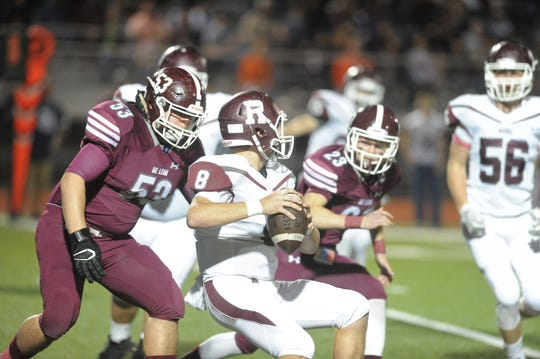 De Leon defensive lineman Colton Smith (53) closes in on Riesel quarterback Steven Searcy for a sack in the first quarter.