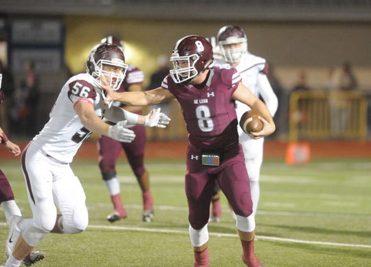 De Leon quarterback Kevin Yeager (8) stiff-arms Riesel linebacker Dakota Robert on a run in the first quarter.