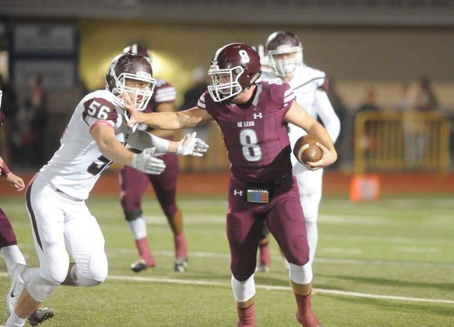 De Leon quarterback Kevin Yeager (8) stiff-arms Riesel linebacker Dakota Robert on a run in the first quarter.