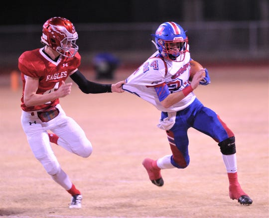 Gorman's Junior Madera, right, tries to slip away from Leakey's Jack Morshead in the Class 1A Division I state quarterfinal playoff game Friday, Nov. 30 2018, at Bulldog Stadium in Brady. Leakey won the game 68-36.