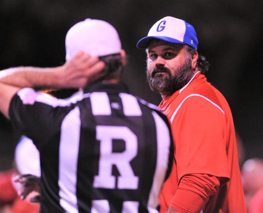 Gorman coach Jeb Dixon talks to an official during the Panthers Class 1A Division I state quarterfinal playoff game against Leakey on Friday, Nov. .30, 2018, at Bulldog Field in Brady. Leakey won 68-36
