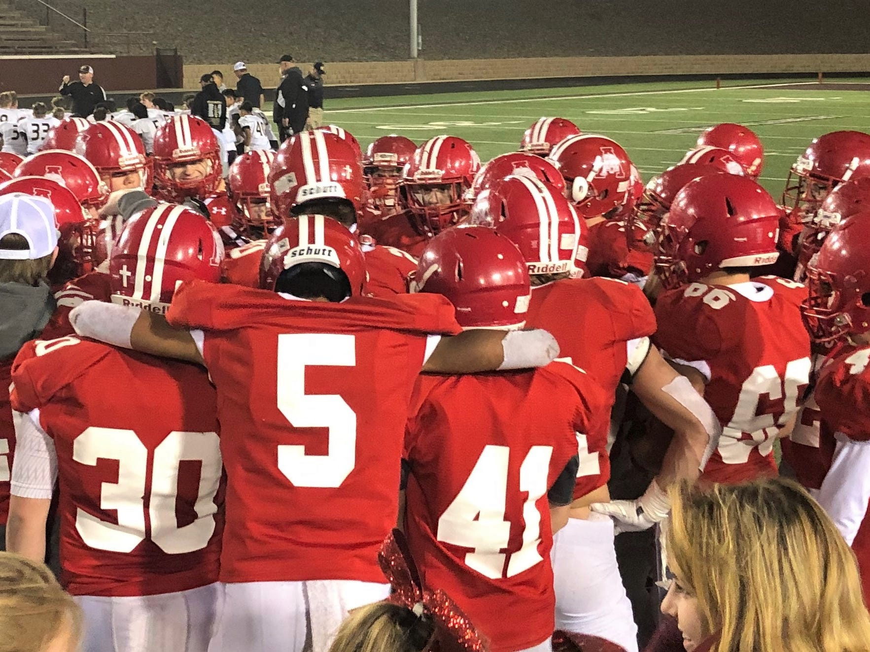The Albany football team meets after defeating Wheeler 48-27 in the Region II-2A Division II semifinal in Vernon on Friday, Nov. 30, 2018.