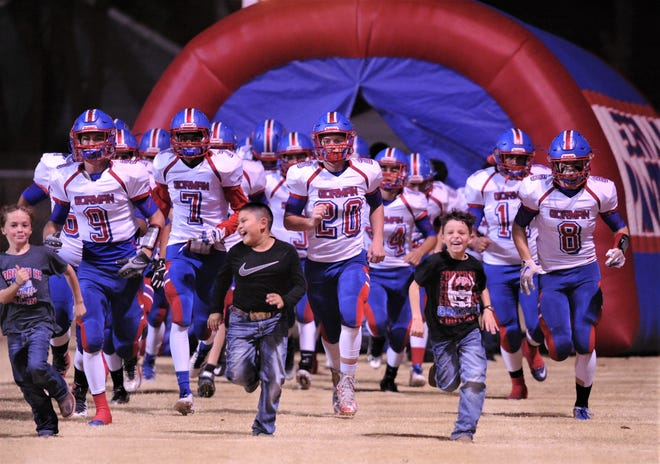 Gorman players run onto the field at Bulldog Stadium in Brady before their Class 1A Division I state quarterfinal playoff game against Leakey. The Eagles beat Gorman 68-36.