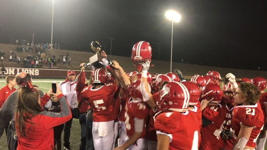 The Albany football team raises the Region II-2A Division II trophy after beating Wheeler 48-27 in Vernon on Friday.