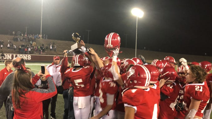The Albany football team raises the Region II-2A Division II trophy after beating Wheeler 48-27 in Vernon on Friday, Nov. 30, 2018.