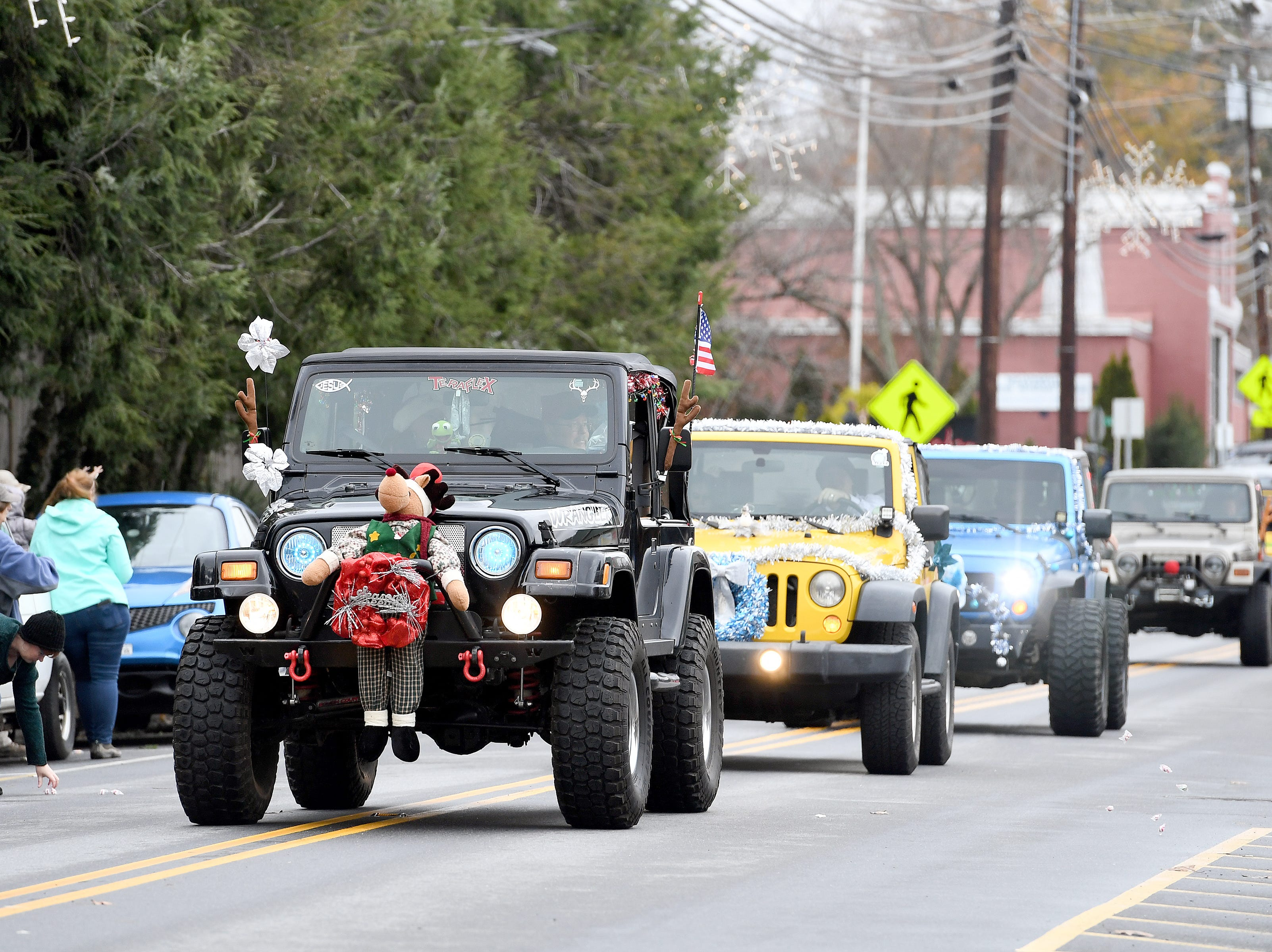 The Jeep Crew makes their way down Main Street in decorated Jeeps as they ride in the Weaverville Christmas Parade on Dec. 1, 2018.