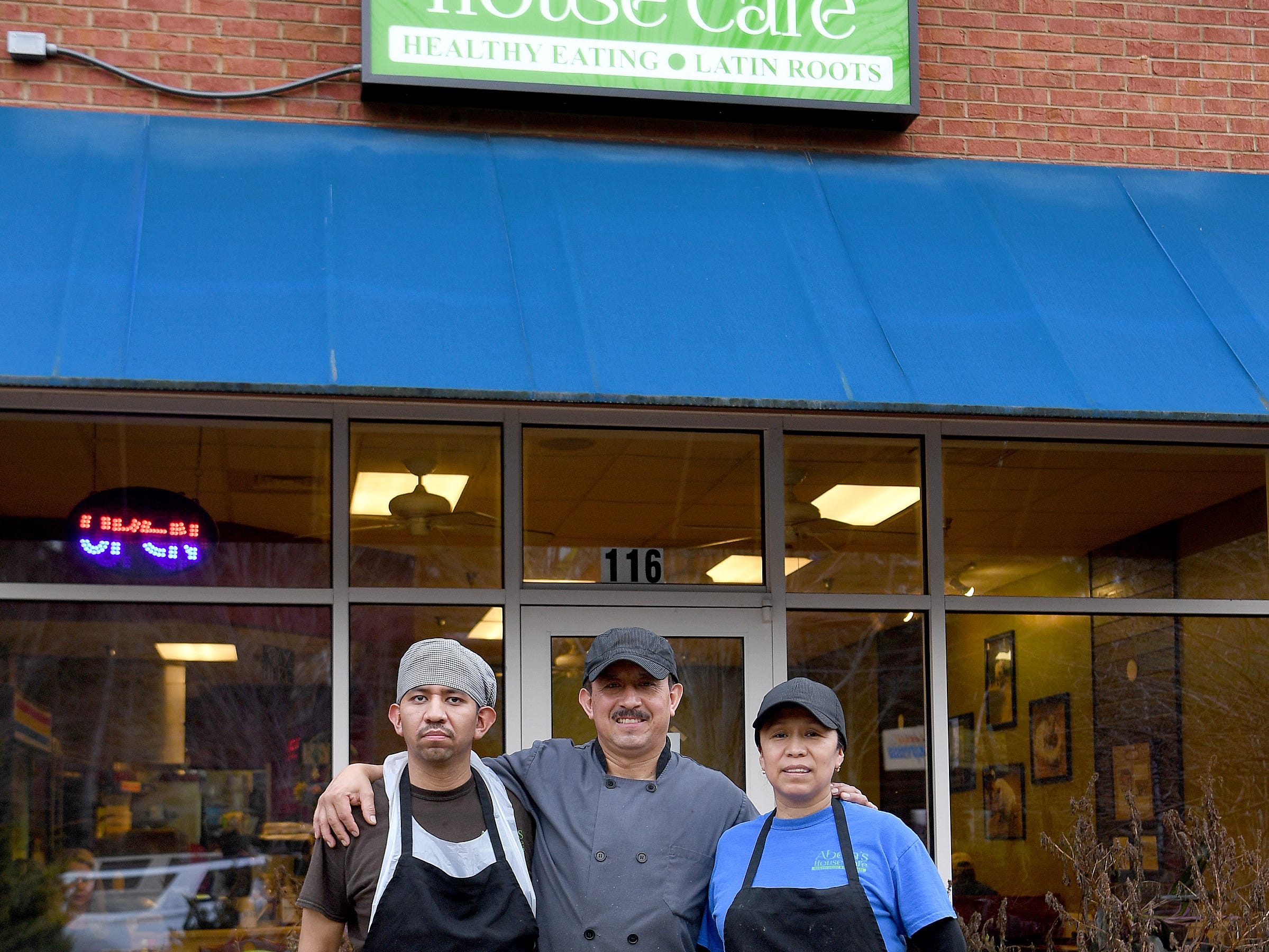 Abeja's House Cafe owners Rafael Lopez, his wife Martha and his son, Rafael, Jr. pose outside of the restaurant on Nov. 30, 2018.