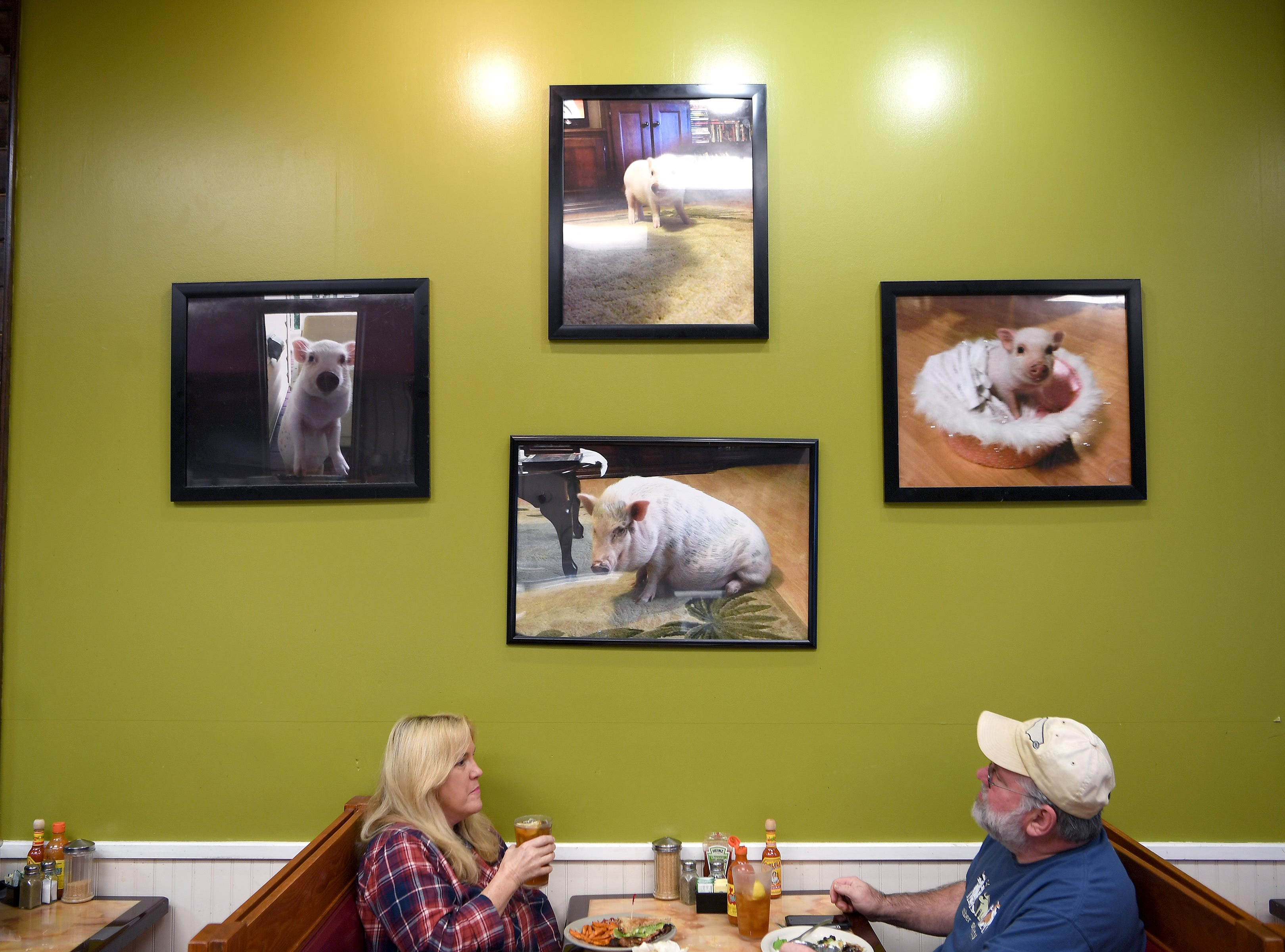 Abeja's House Cafe is named after the owners' family pet pig, Abeja, who is honored in a series of photos on display in the restaurant.