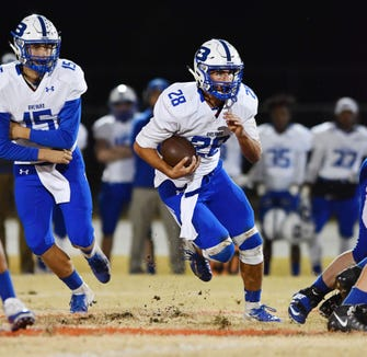 Brevard's Anthony Fields takes a handoff from Mitchell Johnson and digs for yardage against Wheatmore.