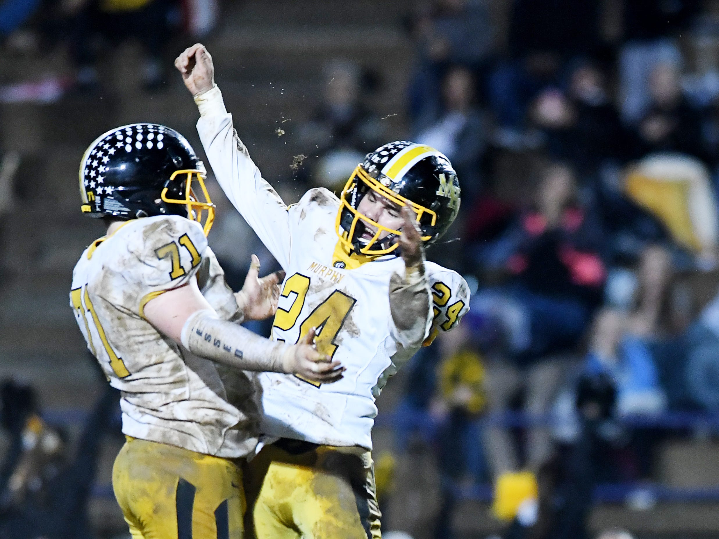 Murphy's Dallas Rayburn, left, and Ray Rathburn celebrate during in the  third round playoff game against Mitchell in Bakersville Nov. 30, 2018. Murphy won, 33-29.