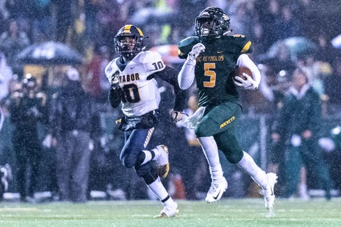 Reynolds' Jhari Patterson runs the ball in for a touchdown during their Friday night third round playoff game against Mount Tabor Nov. 30, 2018.