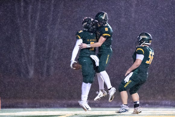 Reynolds' Jhari Patterson and Jackson McCurry celebrate Patterson's touchdown during their Friday night third round playoff game against Mount Tabor Nov. 30, 2018.