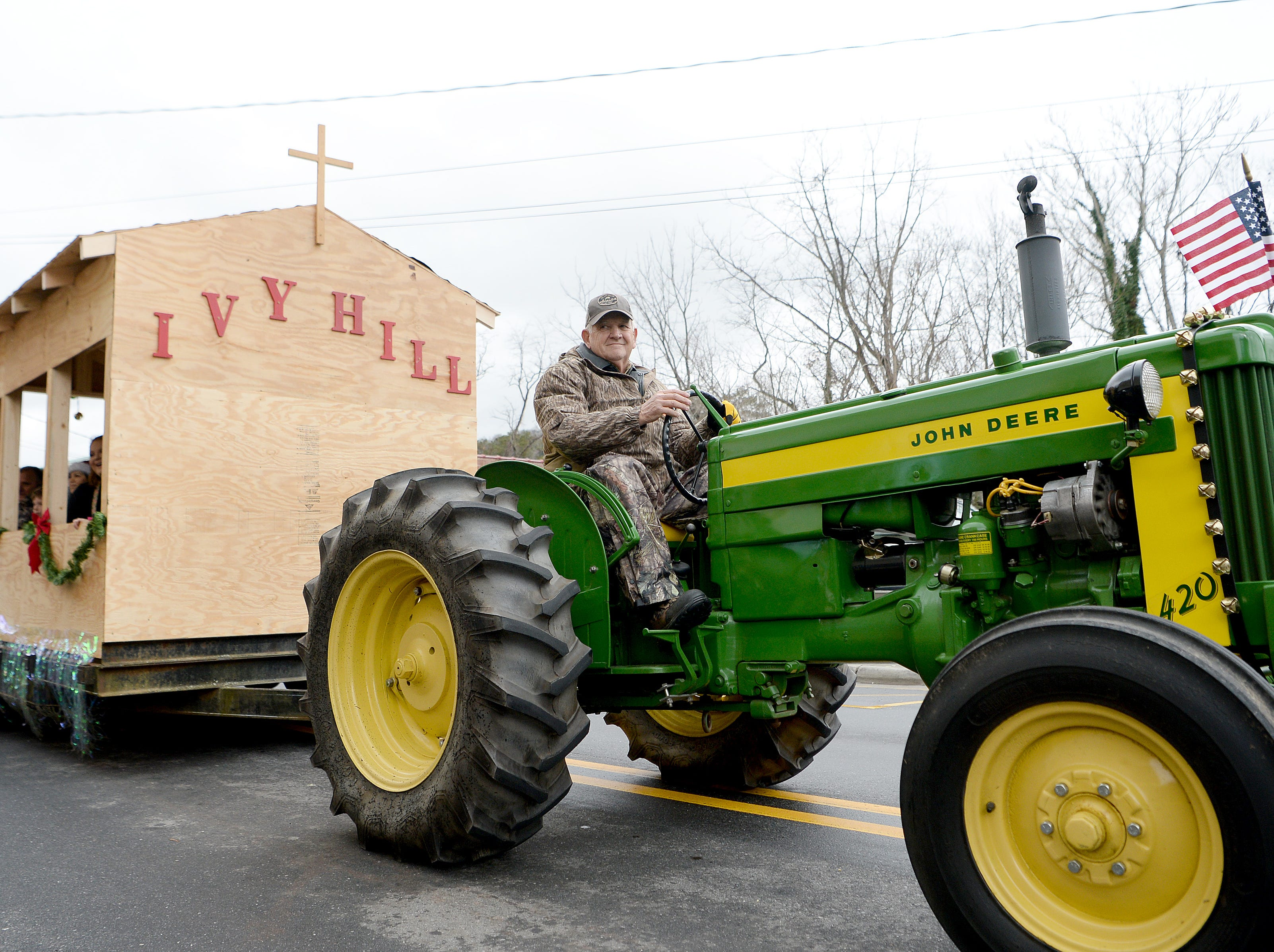 The Ivy Hill Baptist Church float is pulled down Main Street by tractor in the Weaverville Christmas Parade on Dec. 1, 2018.