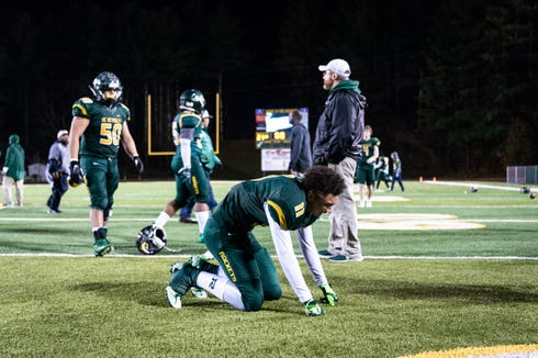 Reynolds' Seth Eberhardt breaks down on the field after their loss to Mount tabor in their third round playoff game Nov. 30, 2018.