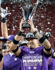 Washington defensive back Byron Murphy celebrates after Washington defeated Utah 10-3 in the Pac-12 Conference championship.