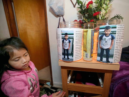 The sister  of Andy Donaldo Calmo, 7, who passed away on Friday, November 26, 2018, from a vehicle accident in Gorst, with donation bins for his body to be returned to Guatemala for burial.