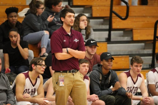 Head coach Clint McElrath looks on during the Warhorses' 73-67 loss to the Roberson Rams on Nov. 27, at Owen High School.