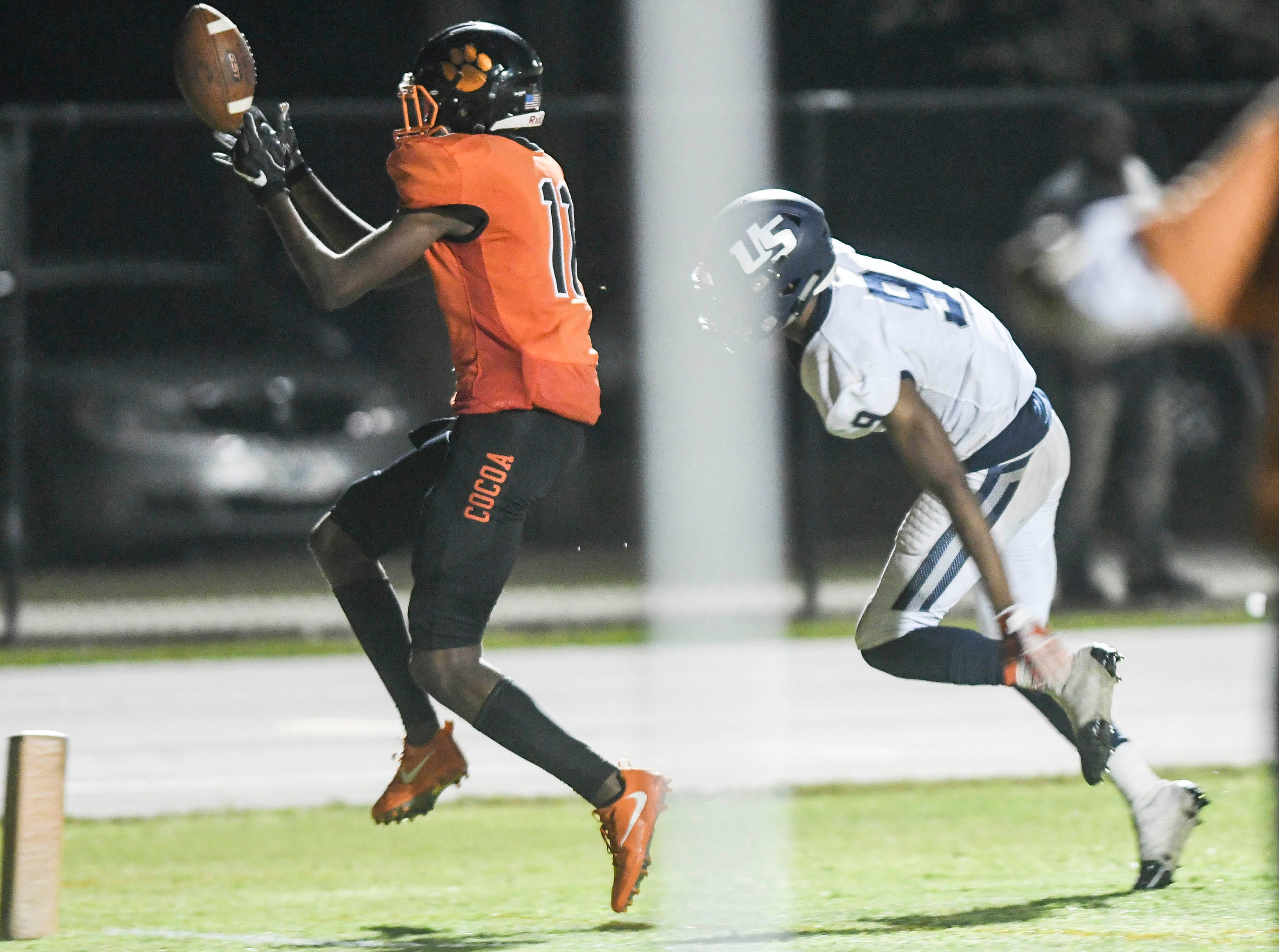 Jamari Williams of Cocoa catches a TD pass late in Friday's Class 4A state semifinal against University.