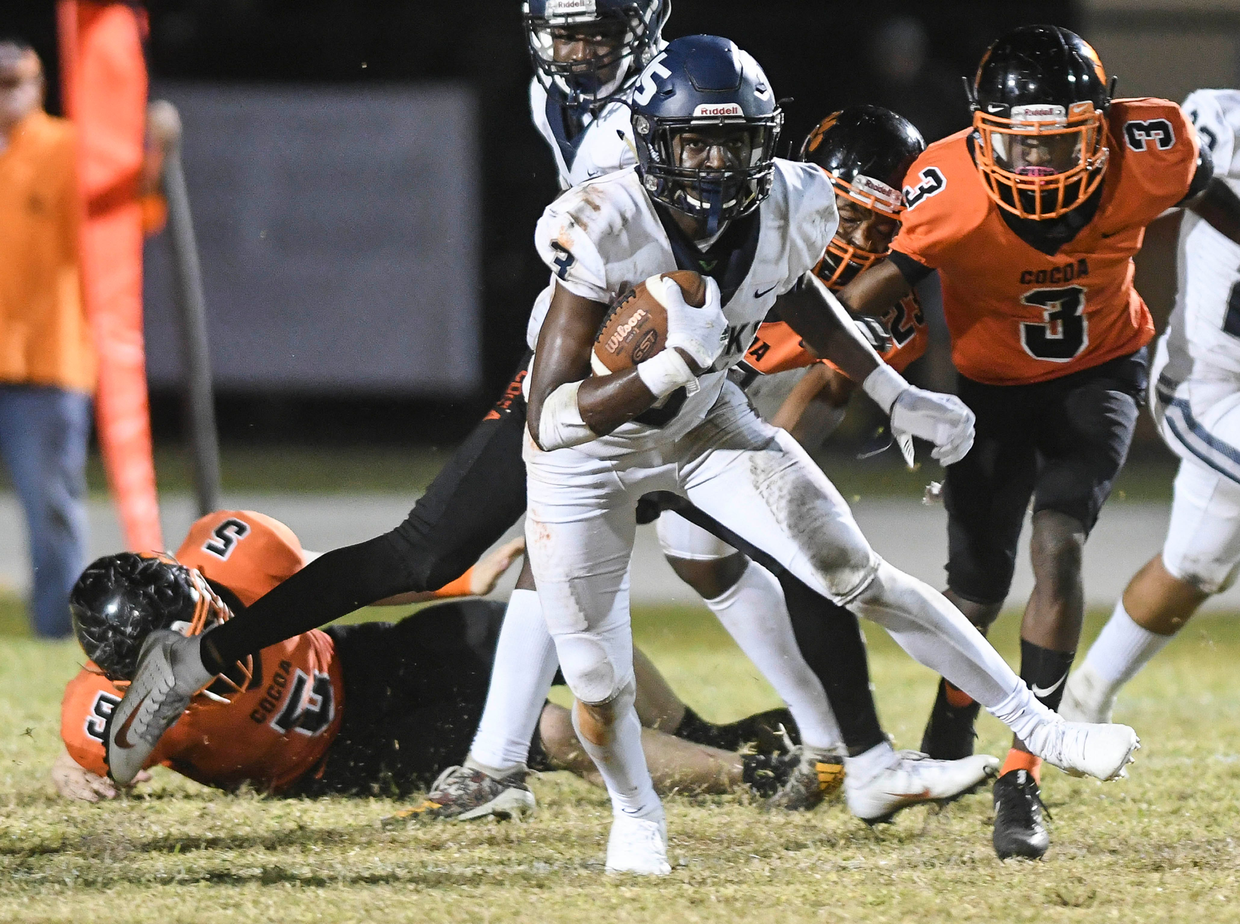 Joshua Sanguinetti of University looks for running room during Friday's Class 4A state semifinal against Cocoa.