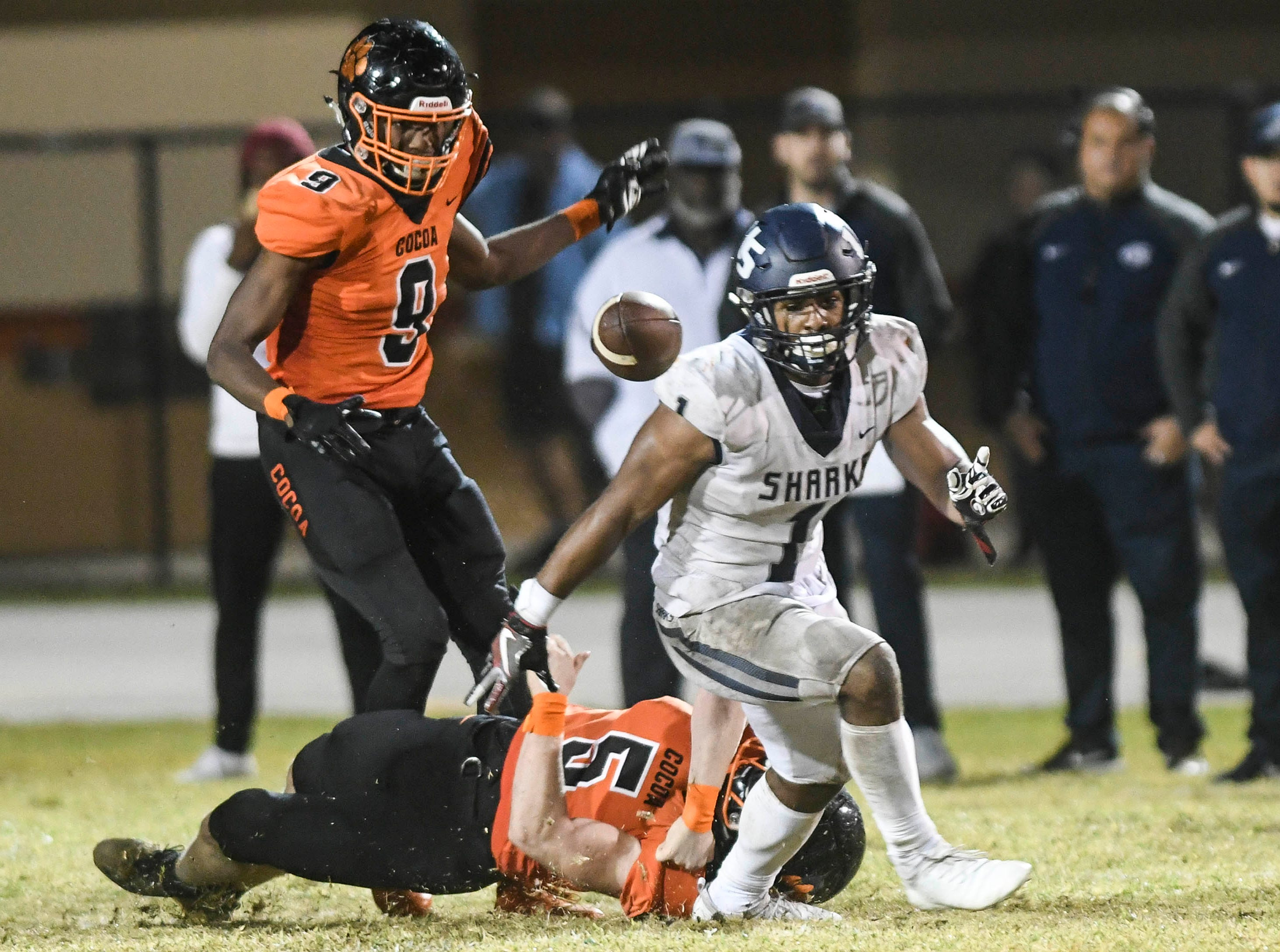 Cocoa's Brock Holland forces Kenny Mcintosh of University to fumble during Friday's Class 4A state semifinal. Willie Gaines would recover the ball for the Tigers preserving their 32-31 victory.