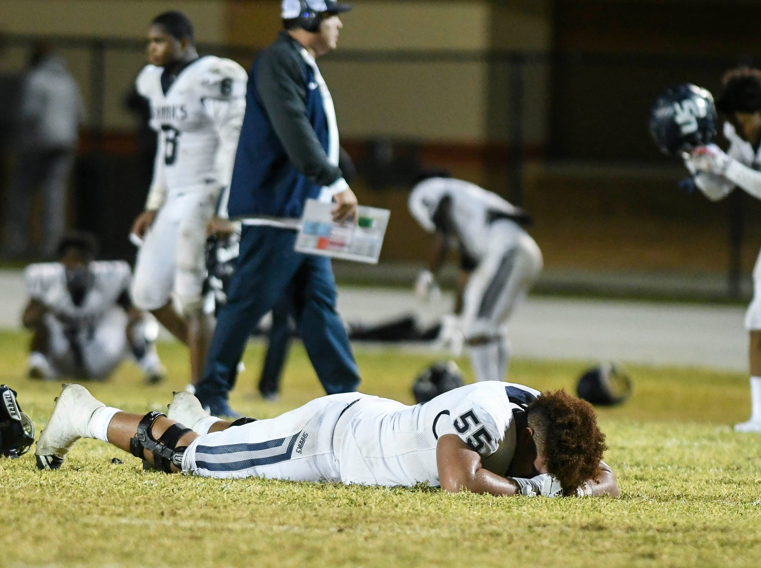 University School players react to losing 32-31 to Cocoa in Friday's Class 4A state semifinal.
