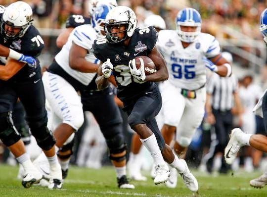 UCF Knights running back Greg McCrae (30) rushes for a touchdown during the first quarter against the Memphis Tigers at Spectrum Stadium.