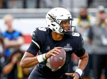 UCF Knights quarterback Darriel Mack Jr. (8) runs the ball on a keeper during the first quarter  against the Memphis Tigersat Spectrum Stadium. Mandatory Credit: Reinhold Matay-USA TODAY Sports