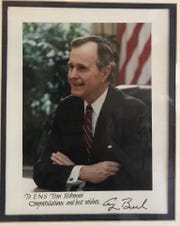 Thomas Francis Rebman worked for former President George H.W. Bush as a member of the Navy Presidential Honor Guard in 1991-1992. Bush gave Rebman a signed photo he gave me when Rebman Commissioned as a Naval Officer.