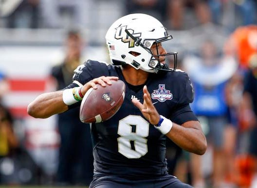 UCF Knights quarterback Darriel Mack Jr. (8) drops too throw a pass during the first quarter against the Memphis Tigers at Spectrum Stadium.