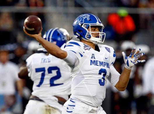 Memphis Tigers quarterback Brady White (3) throws a pass during the second quarter against the UCF Knights at Spectrum Stadium.