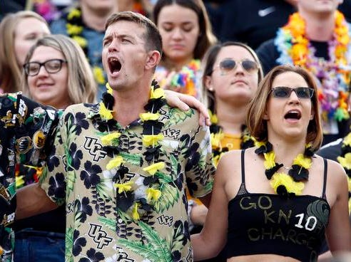 UCF Knights fans ware Hawaiian shirts and lei's  in honor of injured UCF Knights quarterback McKenzie Milton (not pictured) before the game against the Memphis Tigers at Spectrum Stadium. Mandatory Credit: Reinhold Matay-USA TODAY Sports