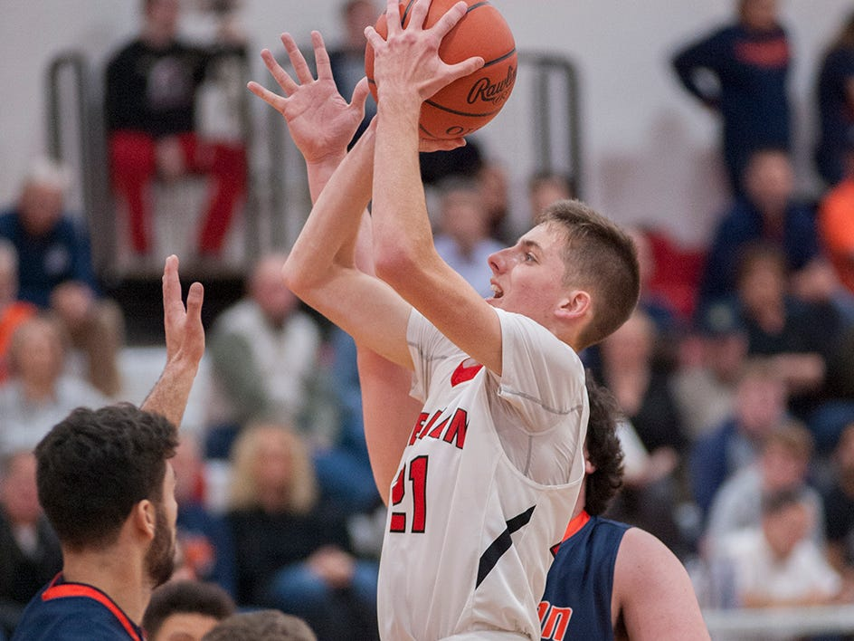 Bucyrus' Lucas Kozinksi puts up a contested layup.