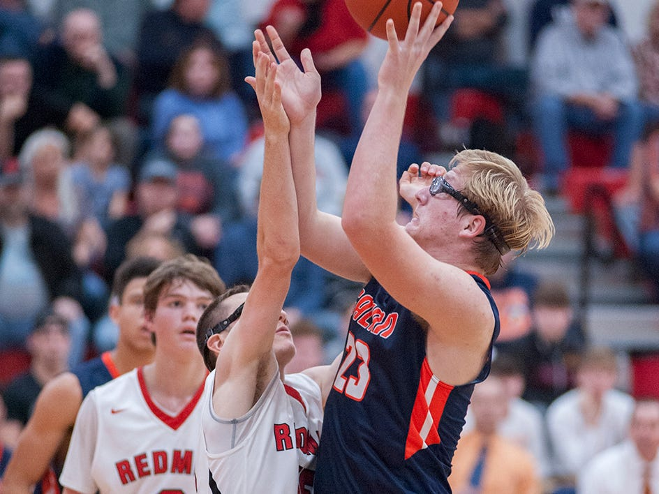 Galion's Stephen Thompson attempts a shot with Bucyrus' Nick Middleton guarding him.