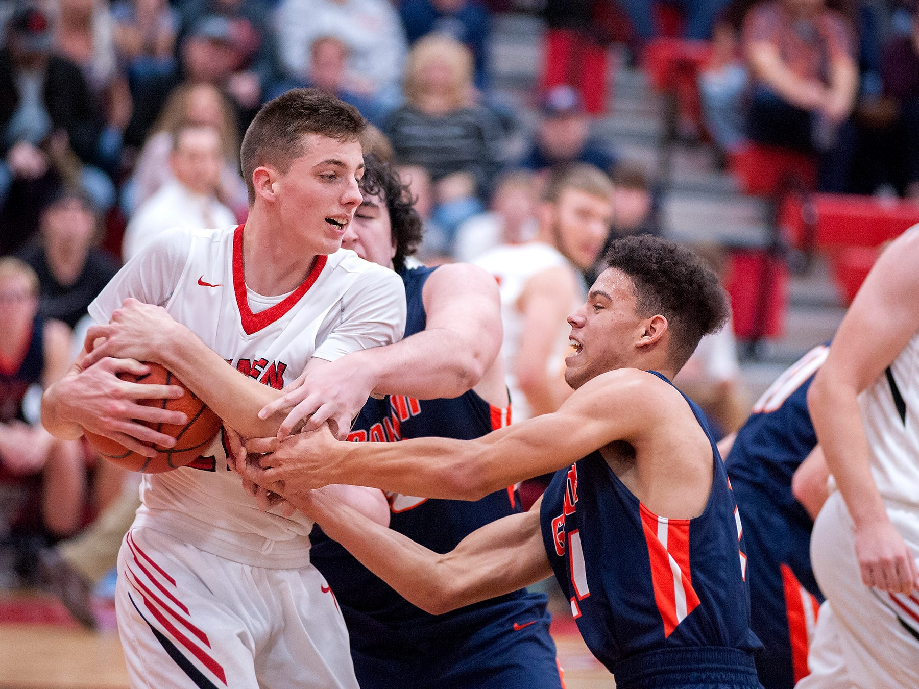 Bucyrus' Lucas Kozinski keeps control of the ball from Galion's Tristan Williams and Hanif Donaldson.