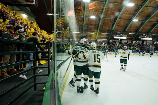 Vermont celebrates a goal during the men's hockey game between the Mine Black Bears and the Vermont Catamounts at Gutterson Field House on Friday night November 30, 2018 in Burlington.