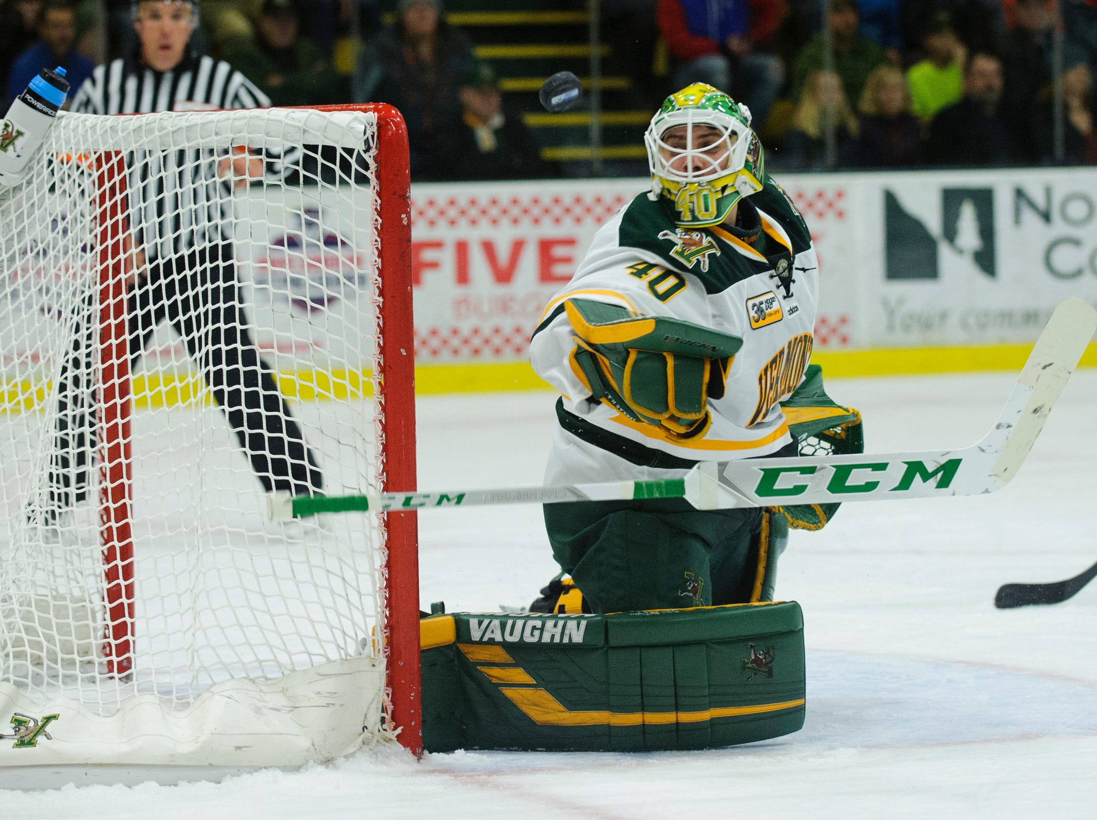 Vermont goalie Stefanos Lekkas (40) loses his stick as he makes a save during the men's hockey game between the Mine Black Bears and the Vermont Catamounts at Gutterson Field House on Friday night November 30, 2018 in Burlington.
