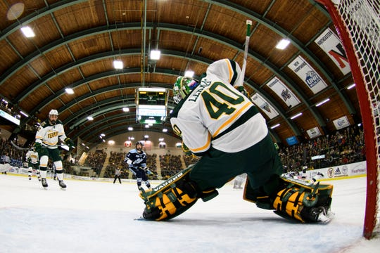 Vermont goalie Stefanos Lekkas (40) makes a save during the men's hockey game between the Mine Black Bears and the Vermont Catamounts at Gutterson Field House on Friday night November 30, 2018 in Burlington.