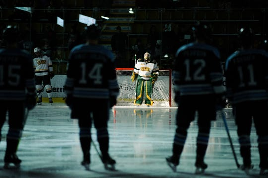 Vermont goalie Stefanos Lekkas (40) waits for his name to be called during players introductions during the men's hockey game between the Mine Black Bears and the Vermont Catamounts at Gutterson Field House on Friday night November 30, 2018 in Burlington.