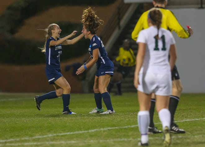 Middlebury's Simone Ameer (right) celebrates her goal with Ellie Greenberg. The Panthers won 1-0 to advance to Saturday's NCAA Division III women's soccer title game on Saturday night.