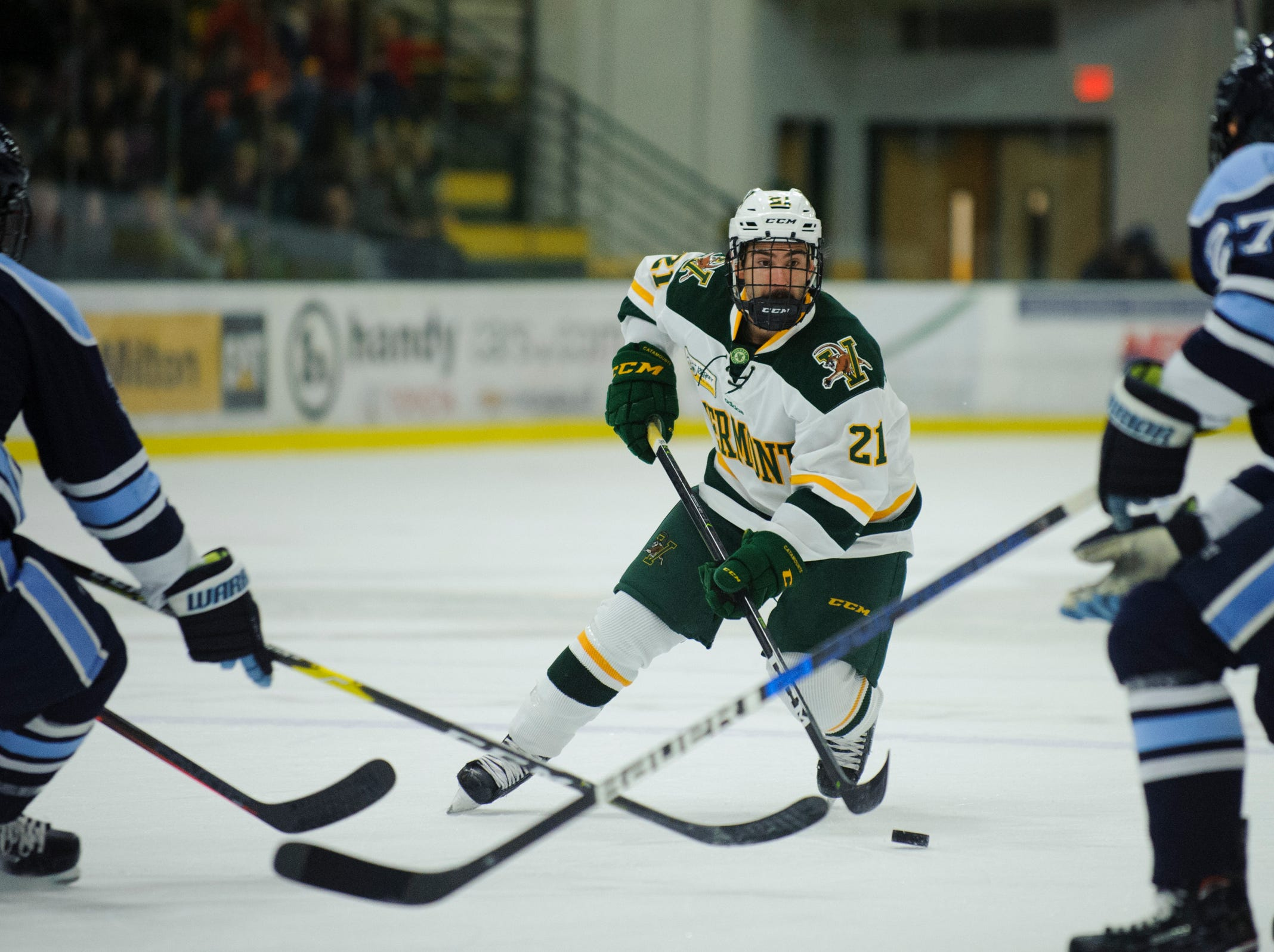 Vermont forward Martin Frechette (21) skates with the puck during the men's hockey game between the Mine Black Bears and the Vermont Catamounts at Gutterson Field House on Friday night November 30, 2018 in Burlington.