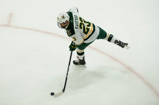 Vermont forward Max Kaufman (23) shoots the puck during warm ups during the men's hockey game between the Mine Black Bears and the Vermont Catamounts at Gutterson Field House on Friday night November 30, 2018 in Burlington.