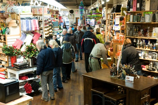 Holiday shoppers crowd Homeport in downtown Burlington just after the doors open on Friday morning November 28, 2008.