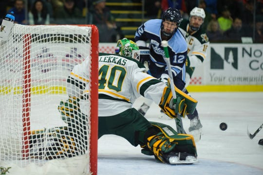 Vermont goalie Stefanos Lekkas (40) denies a goal-scoring chance during the men's hockey game between the Maine Black Bears and the Vermont Catamounts at Gutterson Fieldhouse last season.