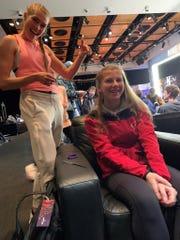 U.S. Olympian Colleen Quigley braids Ailce Veronneau's hair.