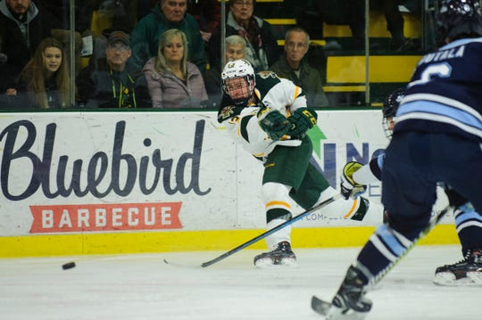 Vermont forward Joey Cipollone (13) takes a shot during the men's hockey game between the Mine Black Bears and the Vermont Catamounts at Gutterson Field House on Friday night November 30, 2018 in Burlington.