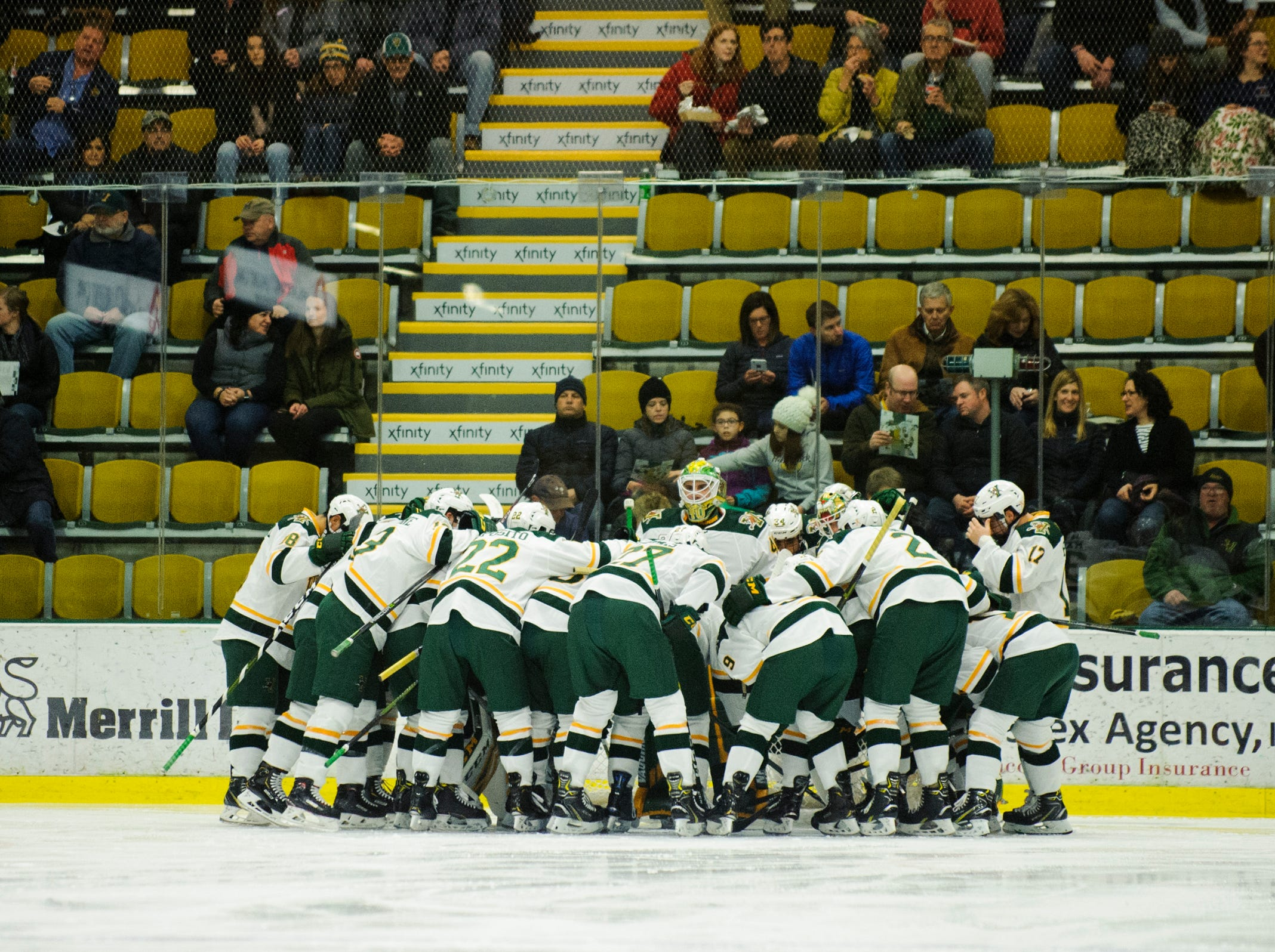 Vermont Huddles together during the men's hockey game between the Mine Black Bears and the Vermont Catamounts at Gutterson Field House on Friday night November 30, 2018 in Burlington.