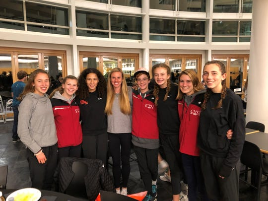 CVU girls cross-country running team poses with U.S. Olympian Courtney Frerichs, who recently set the American record in the steeplechase.