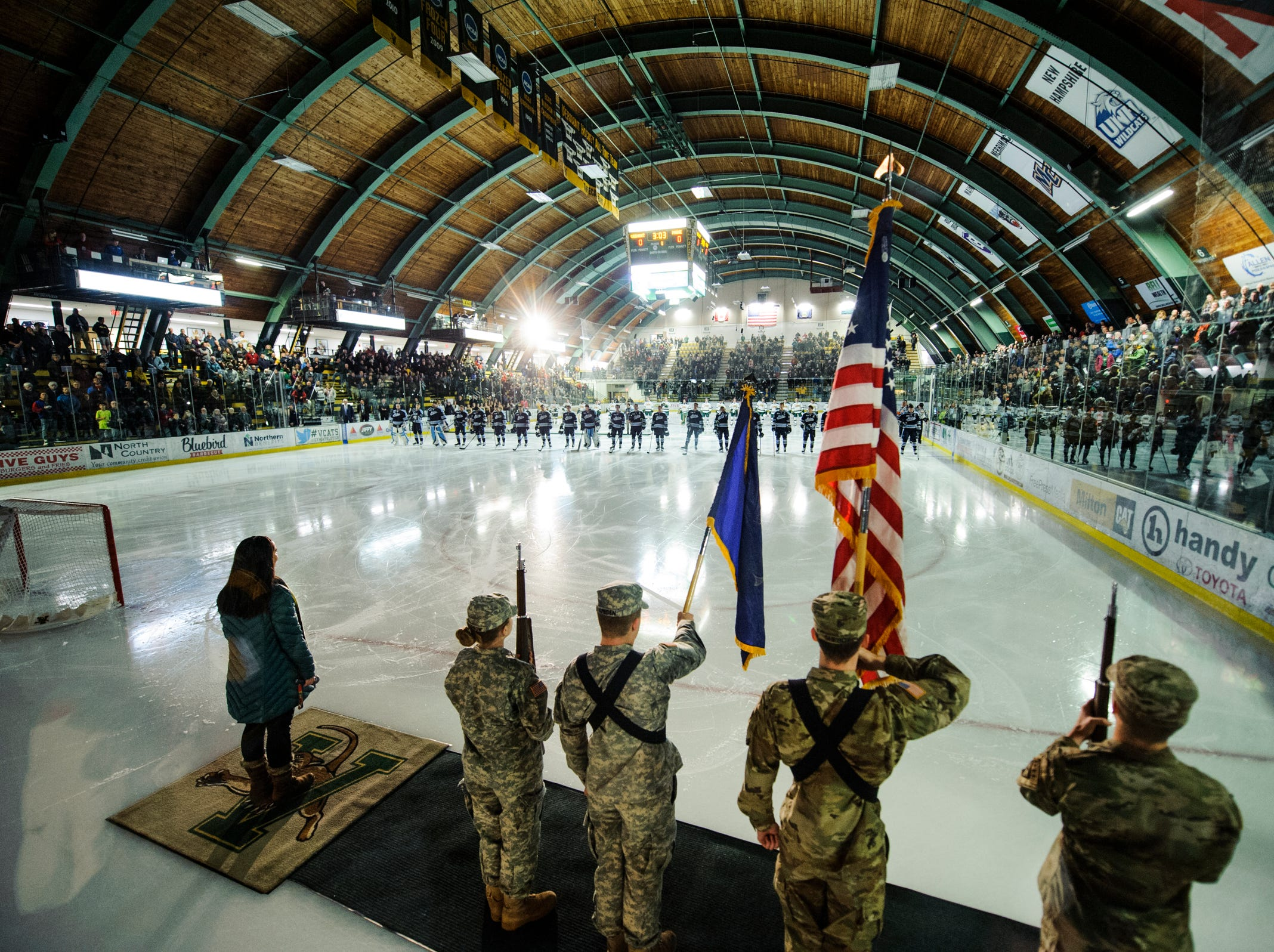 The teams listen to the National Anthem during the men's hockey game between the Mine Black Bears and the Vermont Catamounts at Gutterson Field House on Friday night November 30, 2018 in Burlington.